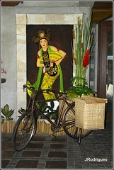 The woman and the bike (JRodrigues.) Tags: woman bike painting indonesia southeastasia baskets 2011 eastjava jawatimur banyuwangi img2351 ketapang ketapangindahhotel