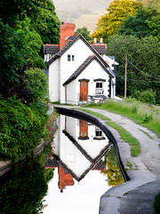 Ty Bach Twt/Little House (c a d i) Tags: trees light white house mountain reflection building tree green home nature water wales town canal day view path walk natur cymru olympus symmetry ty dwr footpath chimneys llangollen lightroom northwales cartref golau camlas gogleddcymru adlewyrchu