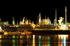 Fawley Refinery and Petrochemical Plant (fatboydon) Tags: trees industry night work reflections river dark lights boat energy ship power smoke tide hampshire cargo steam coastal solent oil petrol yachts southampton shipping chemical petroleum fawley illumnated