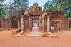 Banteay Srei Entrance Gate (baddoguy) Tags: blue red sky sculpture history horizontal architecture forest photography sandstone gate cambodia khmer religion entrance nopeople unescoworldheritagesite shiva siemreap angkor hinduism ancientcivilization elegance banteaysrei traveldestinations colorimage famousplace pinkcolor siemreapprovince templebuilding eastasianculture stonematerial cambodianculture carvingcraftproduct