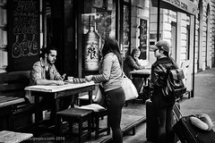 Checking! (gwpics) Tags: blue people blackandwhite bw woman caf girl monochrome lady female bar asian outside person mono blackwhite women hungary exterior outdoor budapest streetphotography lifestyle oriental society eastern socialdocumentary hungarian socialcomment streetpics strasenfotograpfie