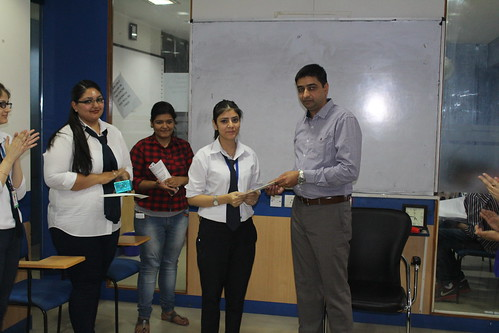 LinguaSoft EduTech's trainer officer getting appraisal letter from CEO Gurvinder Singh Kang