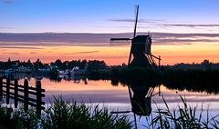 Dutch sunset (marielledevalk) Tags: blue sunset summer sky orange holland reflection reed water netherlands windmill dutch night port river evening harbor boat outdoor serene