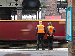 Train Spotting (Deepgreen2009) Tags: station sign train watching platform chester staff passing freight ews
