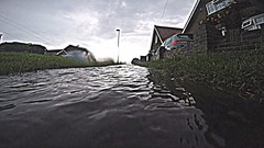 Rain Flowing Fast (bimbler2009) Tags: sky bw motion water clouds movement outdoor urbanlandscape goprohero4black