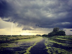 Boating through the thunder storms (k8moonevans) Tags: canal outdoor dtorm storm sky cloud field lanscape algae baot boat narrowboat water landscape skies thunder uk england clouds windmill sun iphone 5se