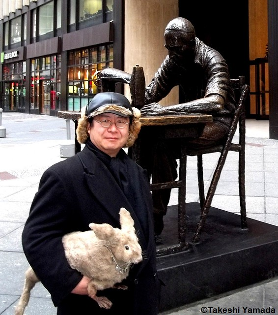 Seara (sea rabbit) and Dr. Takeshi Yamada by the Isaac Singer Statue in Garment District (Fashion District) in Manhattan, New York on December 28, 2011.  20111228 039