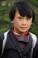 Bhutanese Girl (Mayur Kakade) Tags: life travel school portrait people cute girl beautiful beauty asian photography asia bhutan buddhist buddhism teen portraiture thimpu himalayan bhutanese eartops himayan