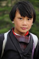 Bhutanese Girl (Mayur Kakade) Tags: life travel school portrait people cute girl beautiful beauty asian photography asia bhutan buddhist buddhism teen portraiture thimpu himalayan bhutanese eartops himayan