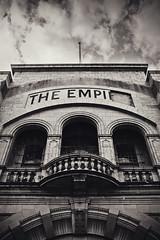 THE EMPI (RE) (Matthew Dartford) Tags: sky blackandwhite cinema broken sepia clouds 35mm logo coast balcony bricks norfolk empire damaged greatyarmouth empi flicks nowhite noblack