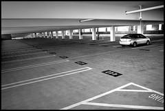 Lone Prius (greenthumb_38) Tags: blackandwhite train blackwhite trains structure amtrak trainstation duotone metrolink fullerton environs parkingstructure digitalblackandwhite canon40d fullertontrainstation jeffreybass