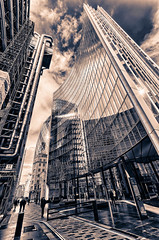 City of London Reflections (tonybill) Tags: city england blackandwhite london architecture buildings places gherkin hdr willis lloyds splittoned snshdr