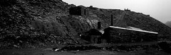 A Slate Quarry above Blaenau Ffestiniog (cycle.nut66) Tags: blackandwhite white black film wet plane 35mm buildings lens grey mine scanner steps olympus om10 epson analogue slate zuiko quarry ffestiniog incline greyscale blaenau 3528 4490