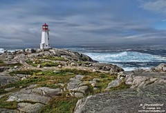 Set on rocky shores, the Lighthouse at Peggy's Cove (PhotosToArtByMike) Tags: ocean sea cliff lighthouse seascape canada landscape coast seaside rocks surf novascotia ns scenic wave peggyscove stmargaretsbay lightstation lighthouseatpeggyscove landscapephotograph peggyspointlighthouse
