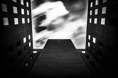 Emergence (adamwcameron) Tags: longexposure sky bw building brick lines architecture clouds canon square blackwhite perspective sigma t3 weldingglass 1750mm 1100d 14stop