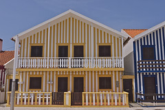 Striped Houses (Amrico Aperta) Tags: city cidade portugal cores seaside raw colours bright stripes riscas litoral beiramar aveiro brilhantes listas costanova stripedhouses casassriscas panasonicdmcgf1 amricoaperta