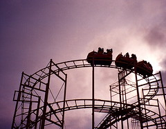 Before the fall (maggyvaneijk) Tags: camera sunset storm cold film rain festival clouds 35mm amusement pier haze brighton track afternoon darkness purple cloudy violet rail roller coaster