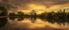 Golden mirror (Blai Figueras) Tags: sunset sky panorama lake water clouds wow reflections landscape lago agua flickr horizon atmosphere paisaje cielo paraiso brilliant estany puigcerd