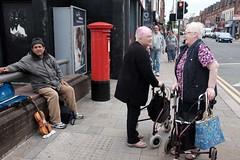 A wee yarn (Moochin Photoman) Tags: street people outdoor candid talk belfast northernireland chatting catchup aweeyarn matchinghairnblouse collarsncuffs