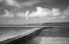 Sennen (Tom McCabe.) Tags: longexposure sea motion water canon landscape blackwhite waves harbour jetty quay rough 30d weldingglass