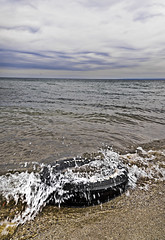 Lost (Gn!pGnop) Tags: blue brown lake black green water burlington landscape waves pollution splash muted