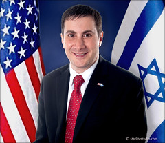 Joe Kaufman in front of American and Israeli Flags