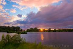 Emberton Sunset (Jamie White.) Tags: trees orange water purple boathouse starburst sunsetembertoncountryparkcanon7dlake