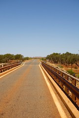 Crossing a Bridge (huskyte77) Tags: road street trip travel bridge november red vacation sky orange tree dusty nature weather tarmac sign canon river landscape eos bush highway flickr day view desert post outdoor oz australia lane outback gps aussie westernaustralia 2470mm 2011 canoneos5d canonef2470mmf28l pannawonica