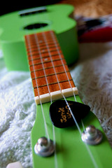 Ukulele (ElCapit4no) Tags: musician music green ukulele strings lime pick plectrum