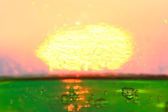 Variations on a sunset #6 : Chemical explosion (kevin dooley) Tags: sunset summer vacation orange sun lake distortion green water glass yellow canon explosion lakemichigan greenslime atomic variations explode variation detergent chemical distort exploding newbuffalo chemicalspill greenpool cuo 40d variationsonasunset
