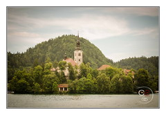 The Church of the Assumption of Mary | Bled - Slovenia (Cristian Sabau) Tags: travel trees vacation favorite lake mountains building history tourism church water colors beautiful architecture clouds boats island photography photo site woods nikon europe flickr european cityscape view place cathedral famous horizon scenic landmark tourist architectural historic slovenia bled destination historical isolated castel attraction touristic turism solvenia turistic slovenian significance skyday d5100