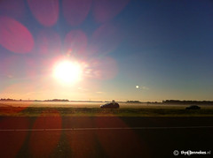 Sunrise (Thijs Tennekes) Tags: morning sun netherlands sunrise lens highway august lensflare flare rise polder a2 2012 thijs iphone thys tennekes