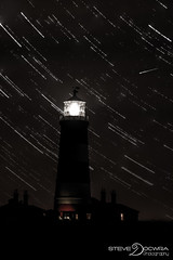 Star trails at Happisburgh (Steve Docwra) Tags: longexposure lighthouse silhouette night shower star august trail shooting swift comet tuttle meteor 2012 happisburgh startrail perseid swifttuttle imagestack stevedocwra