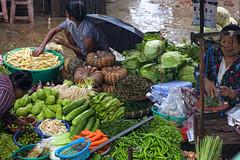 At Market.. (Ye Tun.) Tags: life woman green water vegetables rain season market yangon fresh myanmar kyauktan