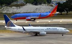 United - N37290 - B737-824 & Southwest - N376SW - B737-3H4 (Charlie Carroll) Tags: tampa florida tampainternationalairport ktpa