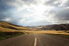 Road to Heaven (Sebastian Hobbs) Tags: california road sun storm tree beautiful field grass lines clouds america canon landscape golden amazing alone unitedstates gorgeous country farmland holy valley sunrays desolate leading cloudscape pathway goldenstate 5dmarkii
