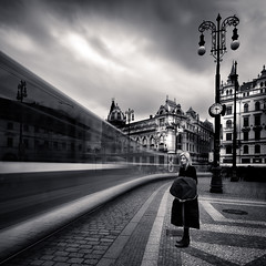 Prague Republic Square (One_Penny) Tags: street city longexposure travel sky urban blackandwhite woman white motion black building clock lamp architecture clouds train dark square photography town driving prague time sinister fineart tram prag praha tschechien motionblur squareformat czechrepublic duotone shutterspeed republicsquare ndfilter nmstrepubliky canon6d
