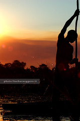 Sunset on a mokoro (Barbara Oggero) Tags: africa travel sunset colour guy nature water river landscape fire boat bush paradise peace wildlife delta safari silence botswana mokoro channels okawango