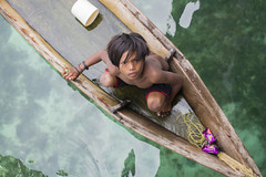 Sea Gypsy Boy in Sampan (boat) (adamraufz.inc) Tags: ocean poverty life wood travel blue sea sky people house home nature water rural relax asian island boat wooden kid asia village child looking outdoor turquoise traditional poor scenic culture floating away scene hut human pre malaysia borneo tropical tropic tradition residential gypsy adolescent interest stilts nomadic semporna mabulisland fotoxpresi adamraufz kembarapulausemporna raufhussin