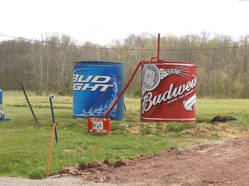 Oil storage tanks painted with Budweiser and Bud Light.