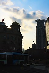 Looking out at the Westin Bund Tower (siddharthx) Tags: china sunset gold golden travels skies shanghai riverside dusk walk azure quay clocktower commercial pedestrians belvedere coffeehouse pudong bund saxophone blacklabel governmentbuildings oldlighthouse sauntering goldensunsets worldfinancialtower financialtower worldtrekker westinbundtower yondering