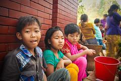 Little Street Sellers (Junayed Sadat) Tags: life street boy portrait colors kids children photography raw faces d70 wide tribal tokina innocence 1224mm bangladesh bandarban lightroom bangladeshiphotographers junayedsadat