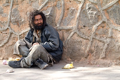 Homeless man in New Delhi (BDphoto1) Tags: poverty india man color horizontal sitting homeless dirty photograph ethnic begging cultural newdelhi socialissues