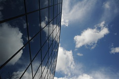 Technology building in a blue sky, puffy little white clouds, day, Bellevue, Washington, USA