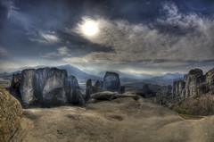 meteora (dtsortanidis) Tags: world travel sun mountain colour texture nature beautiful clouds photoshop canon river skyscape lens wonder landscape photography interesting rocks europe heaven colours power dynamic natural earth stones mark hill unesco fisheye explore greece filter ii l 5d geology fullframe ef dynamism hdr impressive mk 815 dimitris f40 meteora dimitrios photomatix explored suspendedrocks canon5dmarkii 815mm tsortanidis