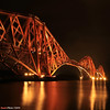 Made in Scotland from Girders (SwaloPhoto) Tags: reflections square coast scotland fife bridges nighttime coastal northsea railways iconic girders afterdark firthofforth northqueensferry cantilever floodlights bythesea bsquare canonef1740mmf4l theforthbridge canoneos5dmarkii
