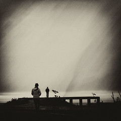 From a distance (. Jianwei .) Tags: sea texture sepia composition dark back couple mood view wind candid grain atmosphere windy human whidbeyisland distance fortcasey  a55 kemily
