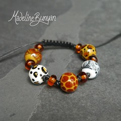 "Animal Print Bracelet • <a style=""font-size:0.8em;"" href=""https://www.flickr.com/photos/37516896@N05/7549937108/"" target=""_blank"">View on Flickr</a>"