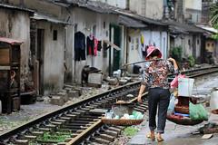 Shoulder Baskets on the Train Tracks (AdamCohn) Tags: market traintracks shoulderbaskets vietnam hanoi adamcohn wwwadamcohncom rails woman street food vendor ngc