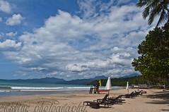 The Beach (lyman erskine) Tags: trees sky beach clouds puerto sand philippines princesa umbrellas palawan